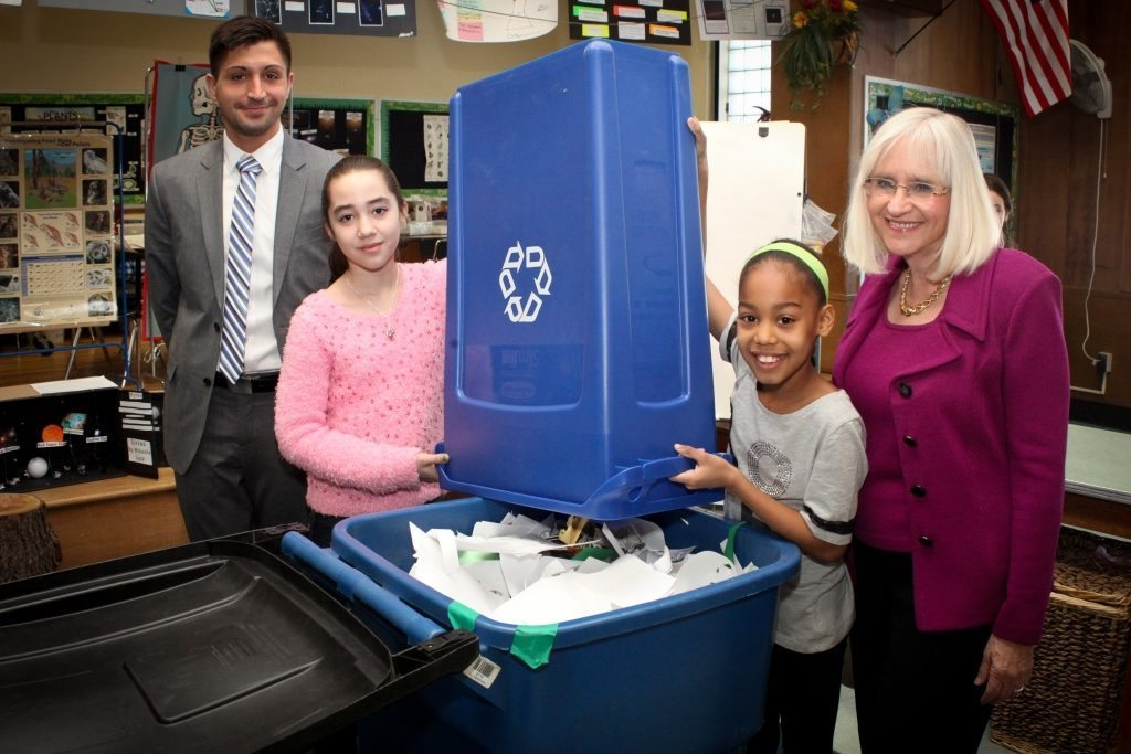 Supervisor Judi Bosworth and Recycling Coordinator Bill Karavasilis meet with students from the Saddle Rock School's Recycling Program on March 6.