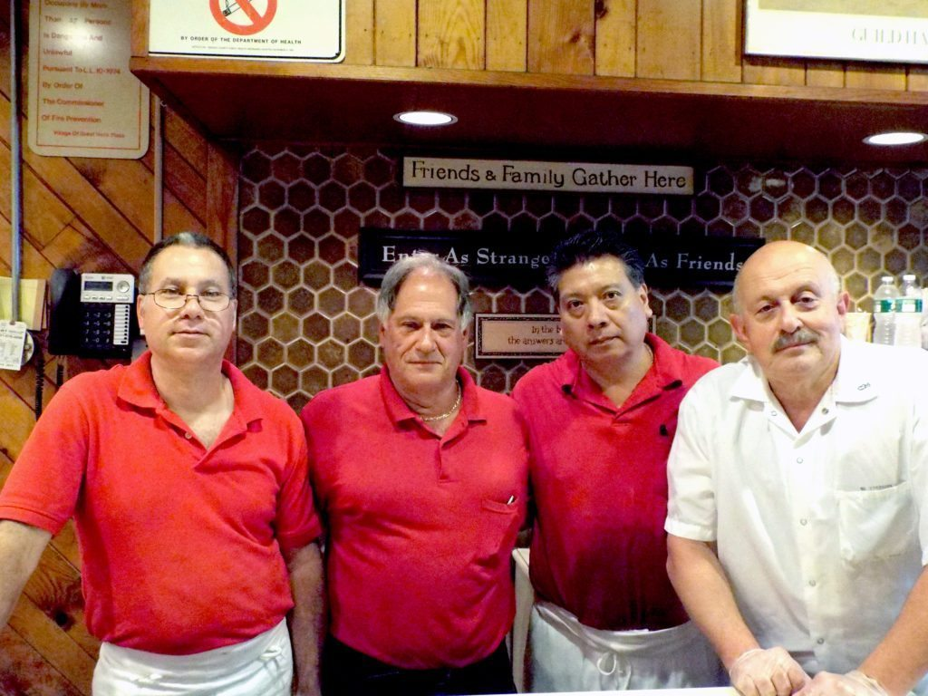 Ready To Serve: Kensington Deli staff members (l-r) Phil Sutton, owner  Paul Saberito, Mario Santos and Simon Tkach.