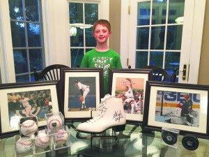 Ian Myer with his collection of sports memorabilia that he will be auctioning.