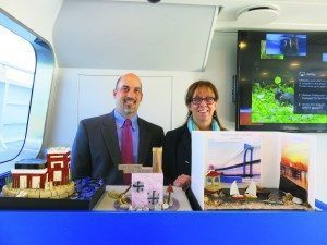 Principal Ronald Gimondo and Assistant Principal Kathleen Murray of John F. Kennedy Elementary School display the projects their students' created to bring awareness to the Lighthouse.