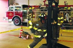 Firefighter Dago Rodriguez showed how to pry a door open using forcible entry techniques.