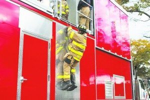 Alert member David Hertz showed how a firefighter would bailout or get out of a burning structure.