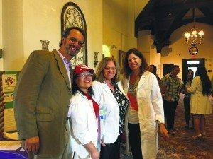 From left: Dr. Paul S. Berg, RNs Merlita Naval-Mendoza, Patricia Magnotta and Marni Rubin, all coworkers of Paz Menjivar, volunteered at the fair.