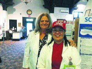 RNs Patricia Magnotta and Merlita Naval Mendoza work at North Shore with Paz Mejivar.