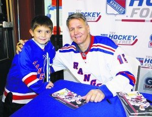 NY Ranger alumnus Mark Janssens signed autographs and offered photos, which put a smile on even the littlest hockey fan's face.