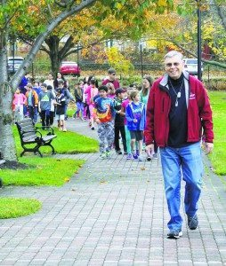 Commissioner Daniel M. Nachmanoff leads the group of students as they enter the park. (Photos by Michele Siegel)