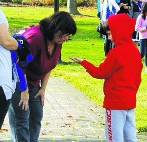 A student gardener shows the Park District's Deputy Superintendent Lisa Goldberg something interesting.