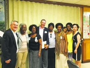 Rabbis Tara and Meir Feldman with the victim's family during their visit to Charleston in July