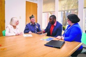 From left: Supervisor Judi Bosworth, Thomas Buzzita, Staff Sergeant Timothy Turane and caseworker Gail Selig