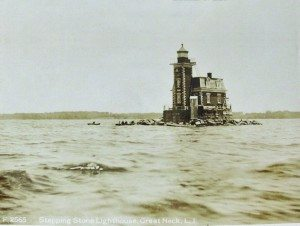 This real photo postcard of the lighthouse shows people in rowboats around 1910.