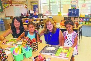 On the first day of school, the superintendent visited the John F. Kennedy Elementary School.