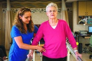 Physical Therapist Assistant Paulina Liboska works with patient Sara Dunlop.