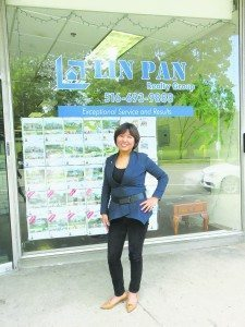 Lin Pan began selling real estate to earn some extra money for her family and, through hard work, now has her own agency. (Photo by Sheri ArbitalJacoby)