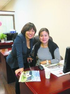 Lin Pan with coworker Teng Annie (Photo by Sheri ArbitalJacoby)