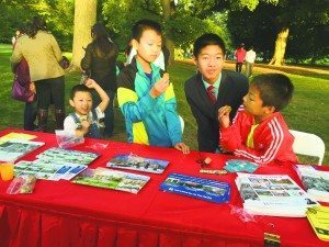 From left: Sons Daniel, Jackey, Robert and Enoch are eating Moon Cakes at the Mid-Autumn Festival at Old Westbury Gardens.
