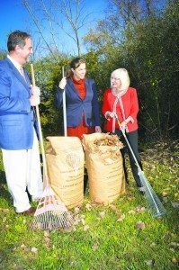 From right: Supervisor Judi Bosworth rakes up some leaves and places them in the new biodegradable paper bags with Chief Sustainability Officer Erin Reilley and Solid Waste Management Authority Executive Director Igor Sikiric.