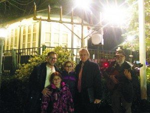 The family of Salomon Nehmad gathered in front of the menorah to celebrate the second night of Hanukkah. From left: Albert Nehmad, Sarina Nehmad, Brooke Nehmad and Moshe Dann (Photos by Isabella Harnick)