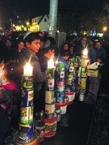 Children from Chabad of Great Neck constructed a menorah out of the cans donated from a recent food drive.