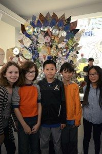 "Students from Lakeville Elementary School stood with ""Lakeville's Pearlescent Peacock."" Pictured, from left, are Kylie Brown, Cooper Brown, Ryan Wong, Sebastian Lennox and Ashley Wu."