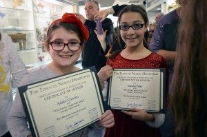 "Ashley Corvino and Isabella Falke, creators of ""The Scream"" from Notre Dame Elementary School, pose with their certificates, recognizing their work as best overall in the elementary school category."