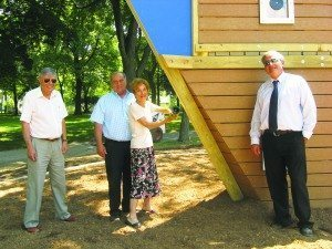 Peter Renick (far right) helped christen the new children's playground ship at Steppingstone Park in 2012 with (from left) Commissioners Daniel M. Nachmanoff, Robert A. Lincoln, Jr., and Ruth Tamarin. As a result of Renick's initiative, this playground promoted imaginative play and social interaction, met ADA (American Disabilities Act) regulations and provided cushioned surfacing for a safer play area. (Photo by Michele Siegel)