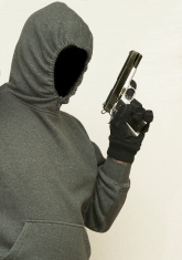 53538894-burglar-with-a-hoodie-and-a-gun