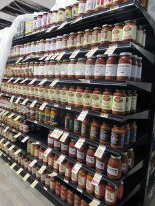 Best Market shelves are being filled in anticipation of the grand opening.