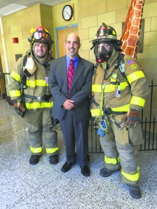 From left: JFK teacher Connor Heaney, JFK Principal Ronald Gimondo and Alert Firefighter Dave Fleshel