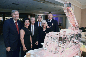 From left: Great Neck Parks District Commissioner Dan Nachmanoff, Councilwoman Anna  Kaplan, Parks District Commissioner Frank Cilluffo, Jay Bosworth, Supervisor Judi Bosworth  and Vigilant Chief Joshua A. Forst stand in front of the stately firetruck ice sculpture.