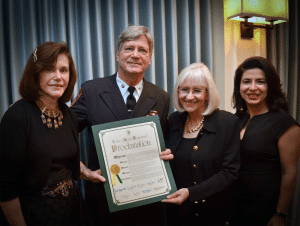 Ludomir J. Czynski, who was presented with the Service Award for 30 years with  the Vigilant Fire Department, is flanked by (from left): Councilwoman Lee Seeman,  Town Supervisor Judi Bosworth and Councilwoman Anna Kaplan.