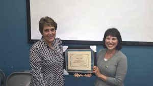 From left: Great Neck Library Board of Trustees President Marietta DiCamillo presented Janet Fine, librarian and head of Circulation/Computer Services, with a certificate of appreciation upon her retirement after 35 years of service.