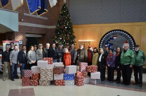 Town officials, Veterans Advisory Committee members and Northport VA officials with all of the donations