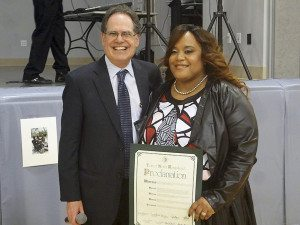 Receiver of Taxes Charles Berman and Desiree Woodson, chairwoman of the Manhasset/Great Neck Economic Opportunity Council