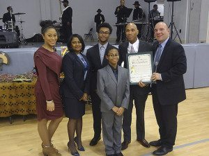 Rev. Victor S. Lewis of Roslyn with his family and Councilman Peter Zuckerman