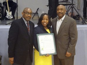 Councilwoman Viviana Russell is flanked by Kenneth and Keith Little, sons of the late Mildred Little of Westbury.