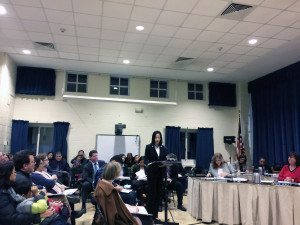 Mimi Hu, communications committee chair for the Great Neck Chinese Association, address the board of ed.