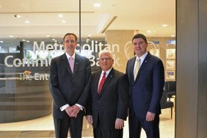 From left: Vice President and Market Sales Manager George Lotto, Vice President and Relationship Manager Ralph Ventura and Assistant Vice President and Assistant Branch Manager Phablo DaCosta stand in front of Metropolitan Commercial Bank's first Long Island banking center.