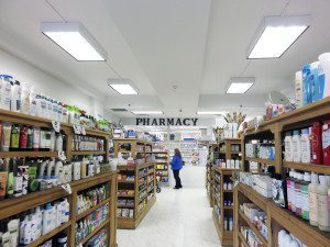 The wooden shelves make the pharmacy feel European.