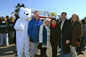 From left: The Polar Plunge mascot, Receiver of Taxes Charles Berman, Supervisor Judi Bosworth, Council Member Anna Kaplan, Town Clerk Wayne Wink and County Legislator Delia Deriggi-Whitton