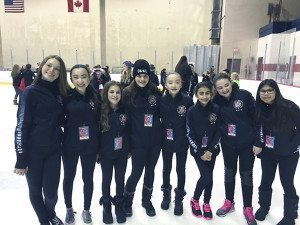 Rebecca Bernstein (third from left), who won a bronze medal in the solo Preliminary Free-skate program, poses here with the Icettes.