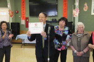 Teacher Lei receiving Gratitude Award