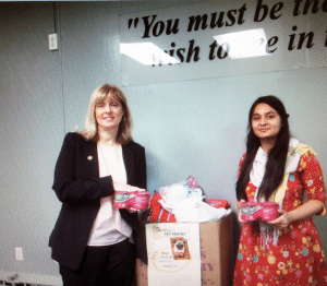 Assemblywoman Michelle Schimel and Great Neck South High School's Kulsoom Rasheed collected 277 pounds of dog and cat food, treats, kitty litter and pet toys last year.