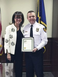 Lt. Michael Conlon was presented with a proclamation by Mayor Susan Lopatkin.