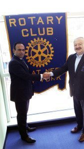 From left: Jacob Cherian, chief executive officer of SMC Global USA Inc., with Leonard N. Katz, president of the Rotary Club of Great Neck