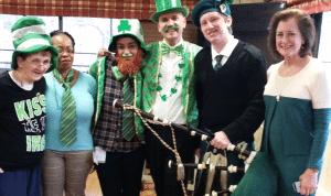 From left: Eileen Delgenio, resident; Velma Crawford, recreational therapist; Francesca Welhous, recreational therapist; David Sterling, assistant director of Therapeutic Recreation; Patrick Roniger, bagpiper; Mayor Jean Celender