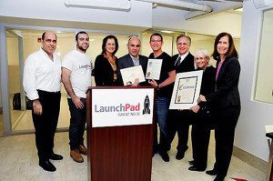 From left: Joel Nandar; Daniel Nandar; Jean Celender, mayor of Great Neck Plaza; Effy Nandar; Andrew S. Hazen, cofounder and CEO of LaunchPad; Ed Mangano, county executive; Judi Bosworth, Town of North Hempstead supervisor; and Ellen W. Birnbaum, Nassau County legislator