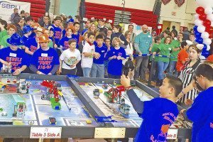 Team members compete at the FIRST Lego League Tournament.