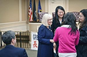 Supervisor Judi Bosworth greets members of the GNCA.