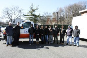 From left: GNWPCD Assistant Superintendent Thomas Dixon, Superintendent  Christopher Murphy, New York Institute of Technology Professor Burton Roslyn (second from right) and students stand in front of one of the district's service vehicles.