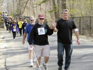 Former deaf-blind student Jon Gabry (left) with his father at last year's Helen's Run/Walk
